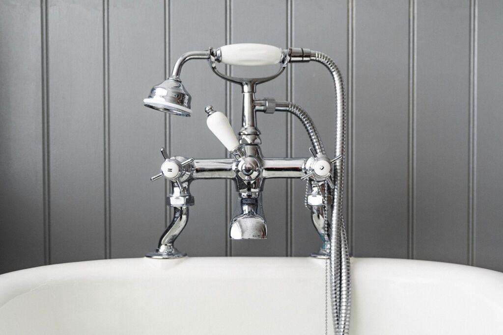 Modern fancy shower on gray background - PHR Plumbing