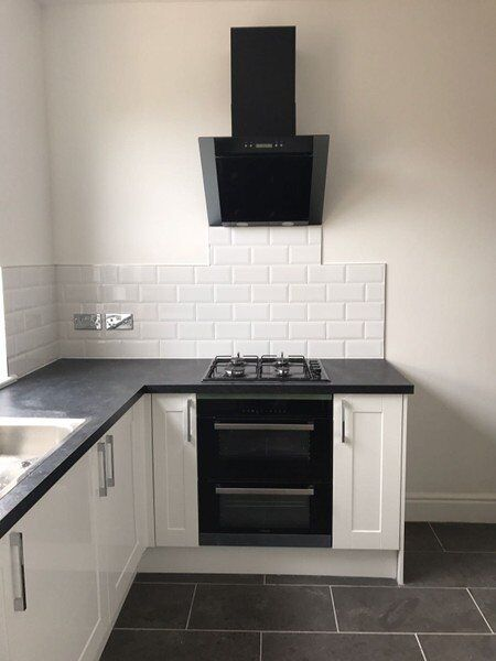 Black and white refurnished kitchen - PHR Plumbing